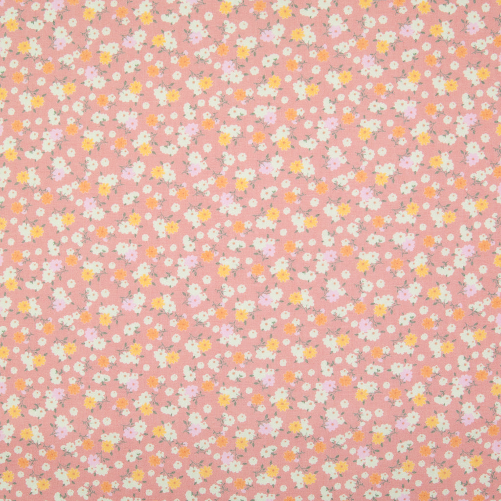 Tiny bunches of pink, orange and white flowers on a dusky pink Rose and Hubble cotton poplin fabric pictured flat