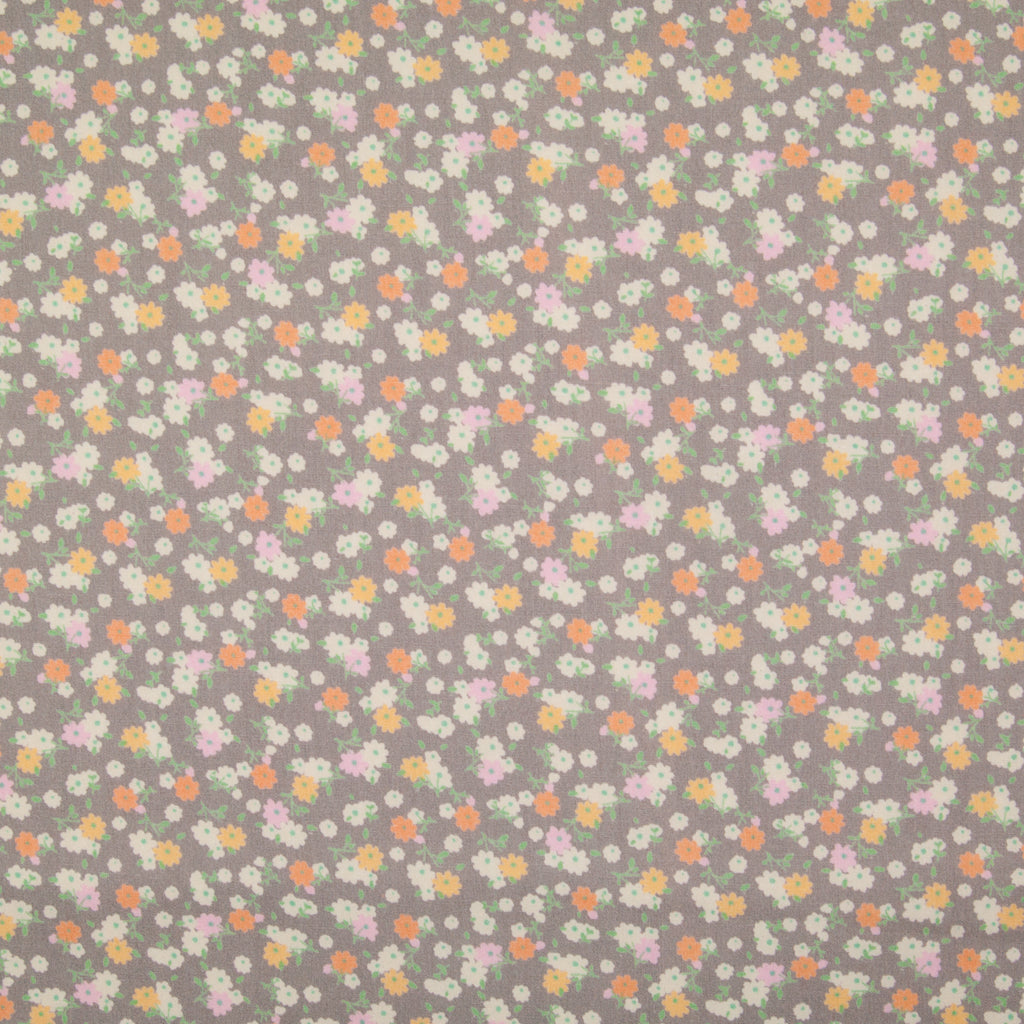 Tiny bunches of pink, orange and white flowers on a taupe Rose and Hubble cotton poplin fabric pictured flat