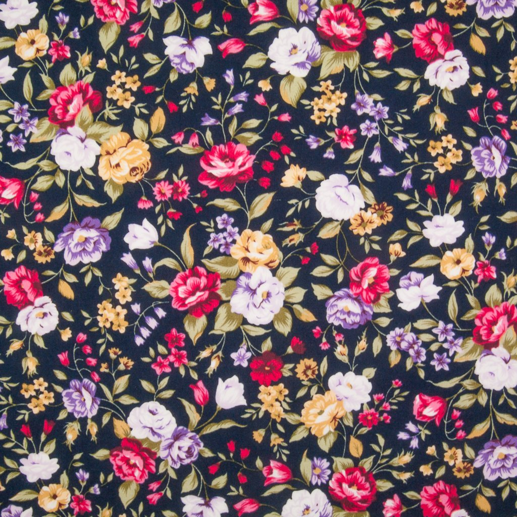 A dense pattern of cerise and lilac flowers in vivid colours printed on a navy Rose & Hubble cotton poplin fabric pictured flat
