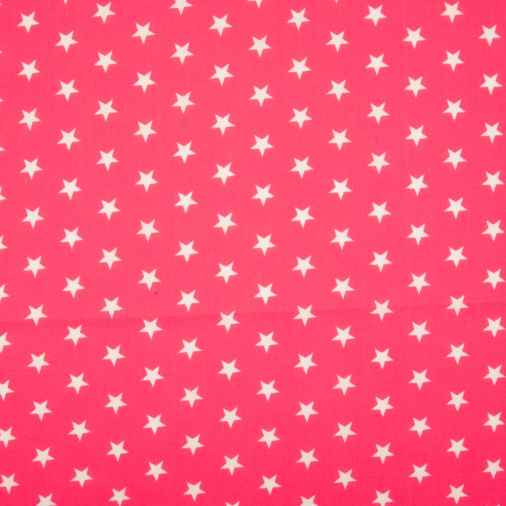 10mm white stars are printed on a cerise polycotton fabric