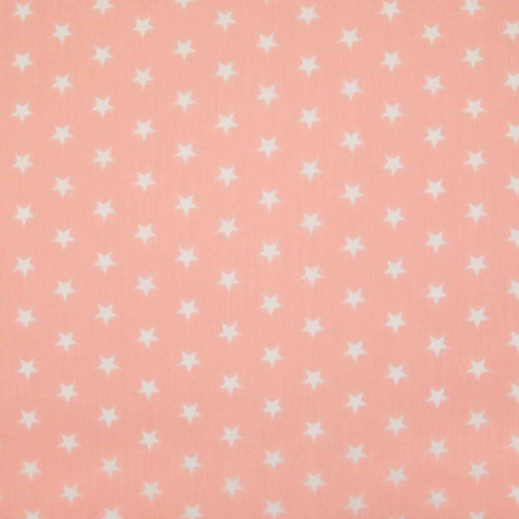10mm white stars are printed on a pink polycotton fabric