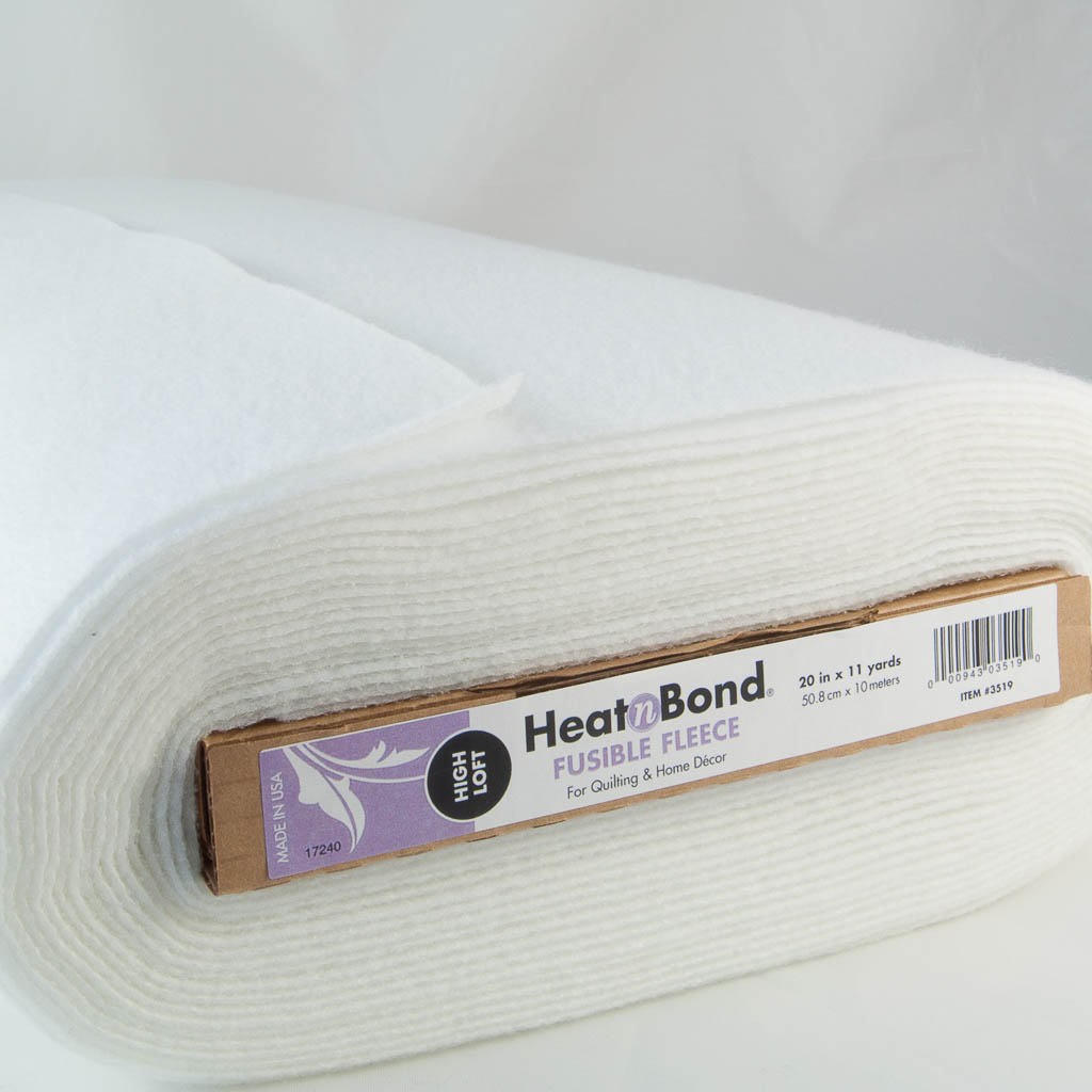 A bolt of heat n bond fusible fleece showing the product details on the bolt end