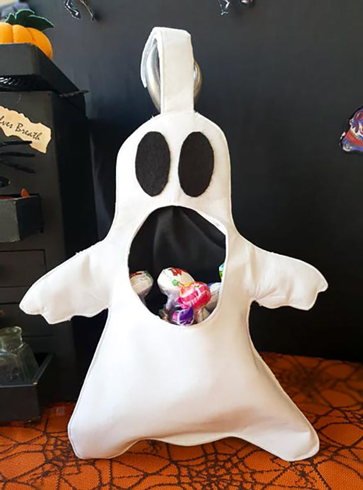 A white ghost shaped halloween goody bag