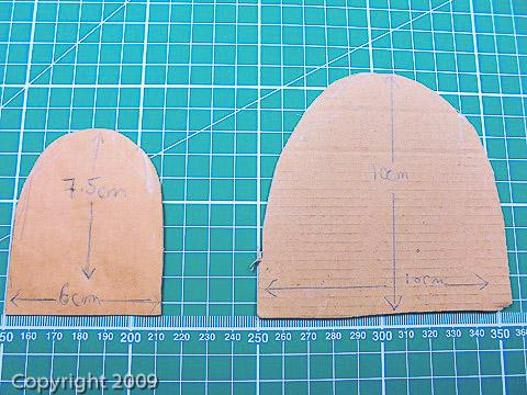 Two different sized cardboard petal templates for making fabric flowers