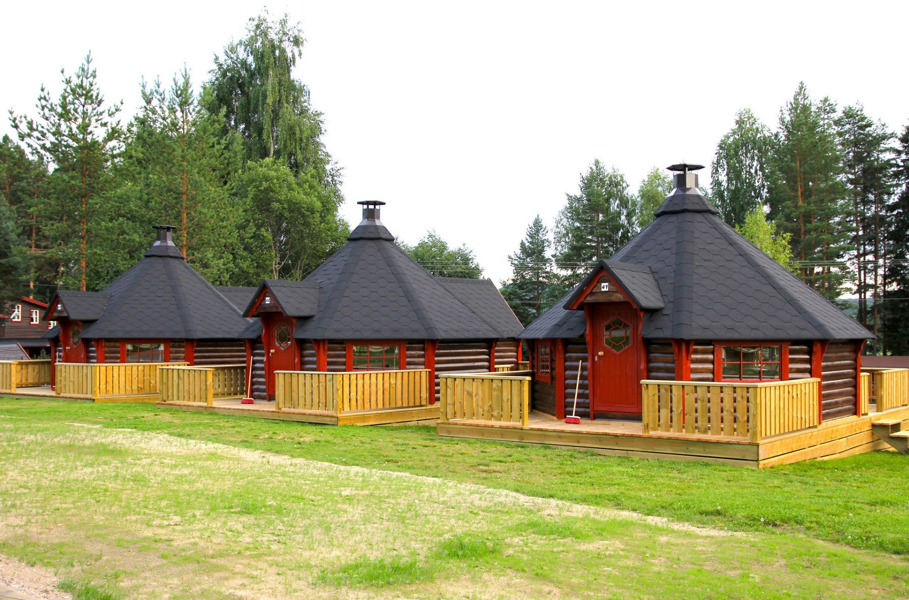 three huge bbq cabins placed on terrace