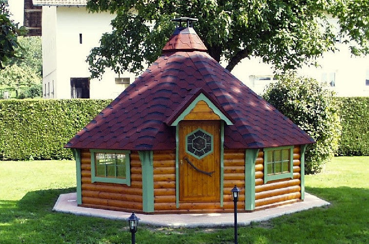 wooden barbecue hut at summer time