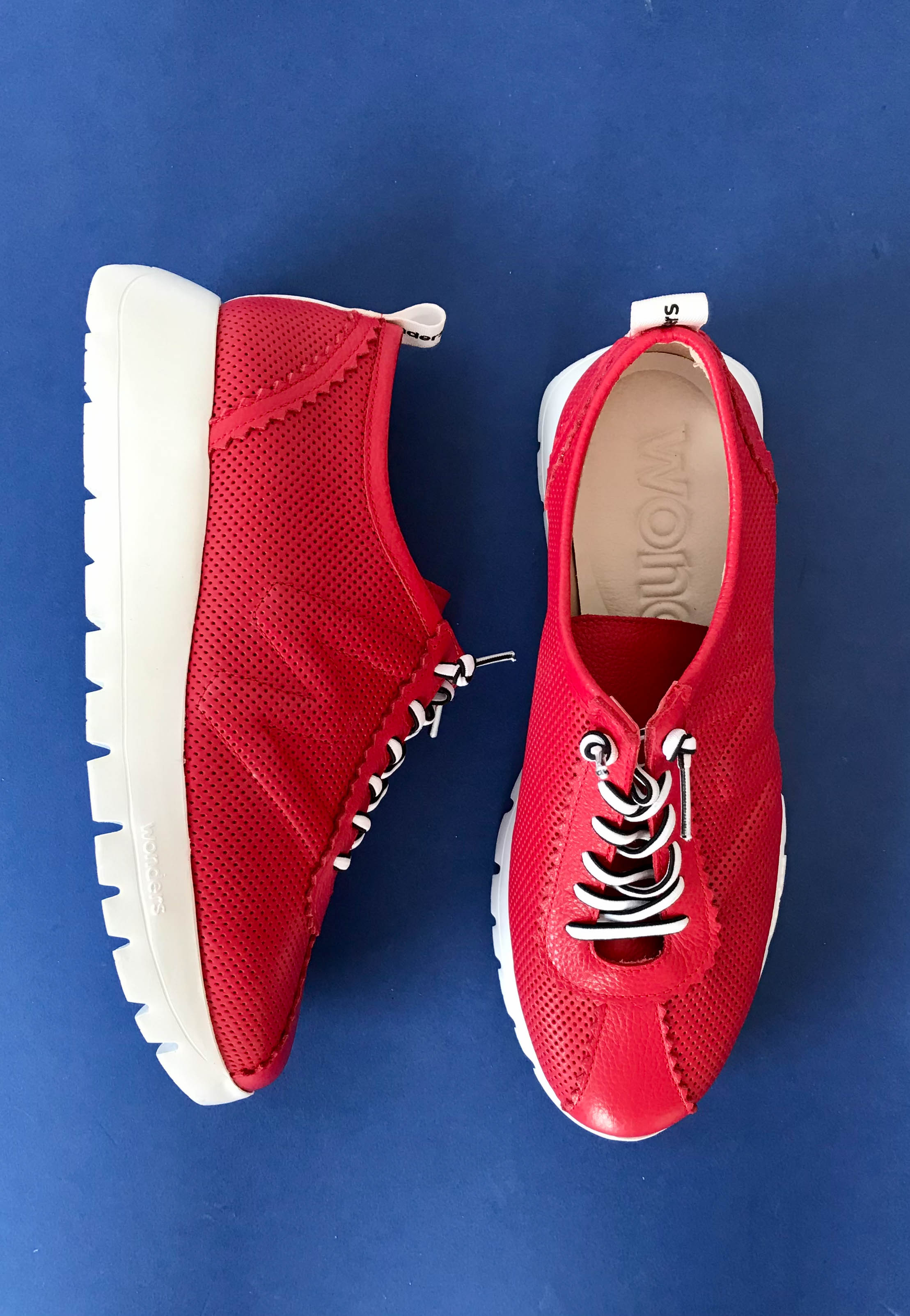 red trainers wonders