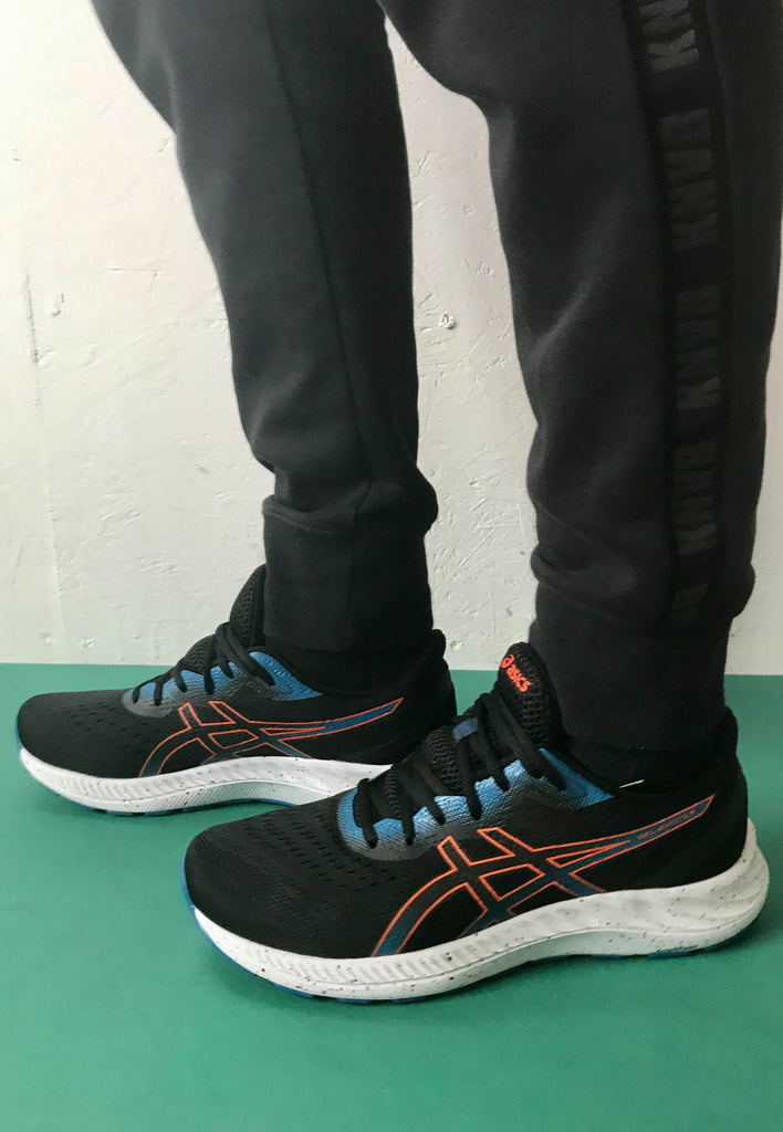 black Asics runners