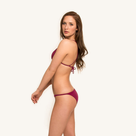 woodlike ocean bikini pant reversible triangle bottom in berry and print color with elastic side string in seamless style side view