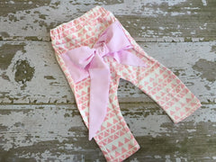 Light Pink and White Aztec Leggings with Bow on Back