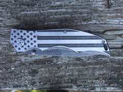 US flag knife graphic on spring assisted knife handle