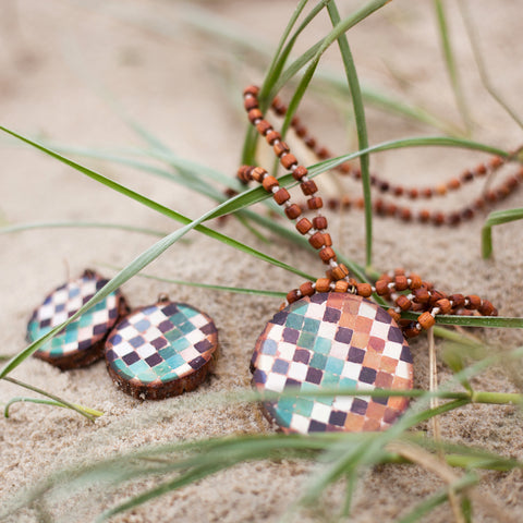 necklaces and earrings handmade on wood by Mon Manabu, featured in Finders Keepers