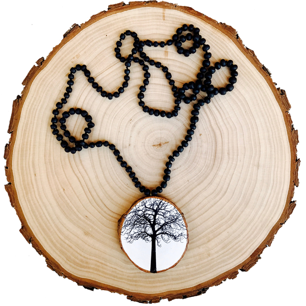 I'm our best selling Necklace. A nature inspired pendant and a boho chic jewellery piece that will open conversations wherever you go.  This unique Tree of Life Necklace shines when worn as a hero piece against earthy, black and white tops or dresses.