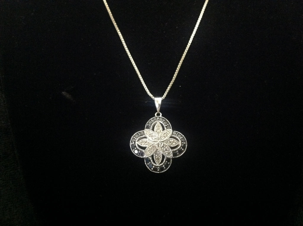 Sterling Silver Floral Pendant with Black and White Diamonds