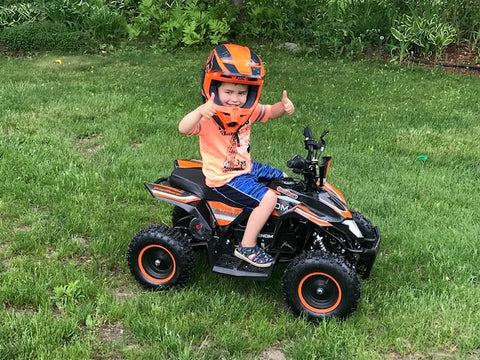 Venom Motorsports battery powered electric ATV with 4 year old rider