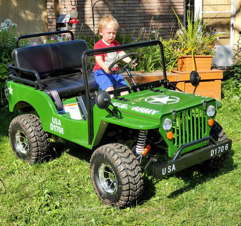 willy's 125cc mini jeep in army green with 6 year old rider