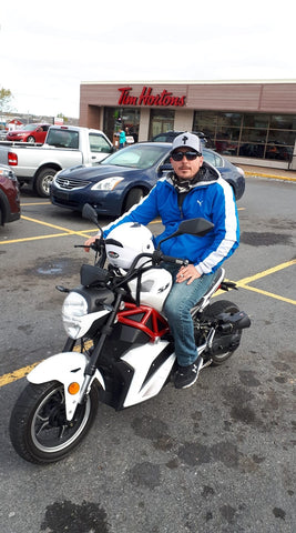 DF50SRT venom x21 50cc in white sizing with human beside it