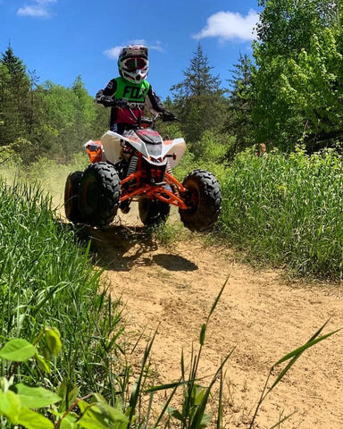 Venom Racing Madix 125cc ATV from venom Motorsports jumping hill with rider