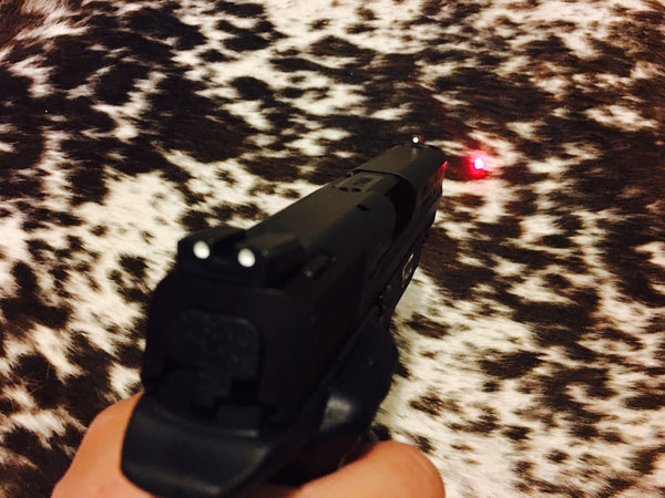 S&W M&P 9MM WITH CRIMSON TRACE LASER GRIP