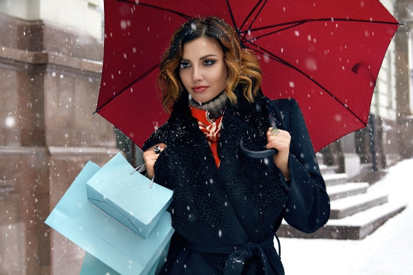 Woman Shopping in the Snow