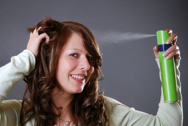 Brunette Applying Dry Shampoo To Get Rid Of An Oily Scalp ISA Professional