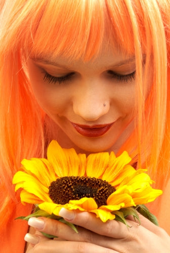 Girl Appreciating a Sunflower- ISA Professional