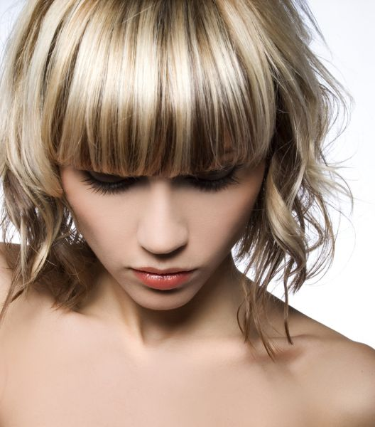 Highlighted Blonde Woman With Short Straight Bangs ISA Professional