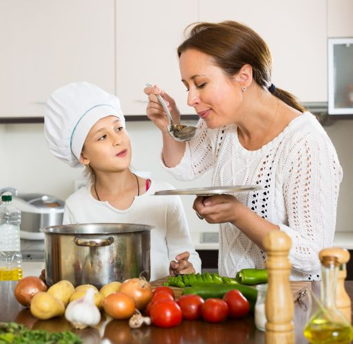 Woman And Daughter Eating A Healthy Meal | ISA Professional