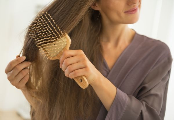 Woman Brushing Her Long Hair | ISA Professional
