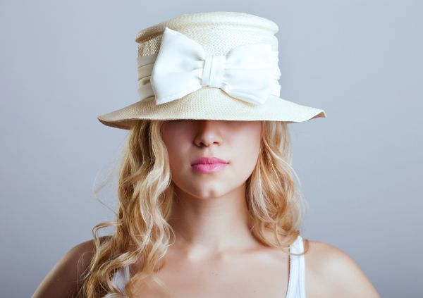 Woman Hiding Behind White Hat | ISA Professional