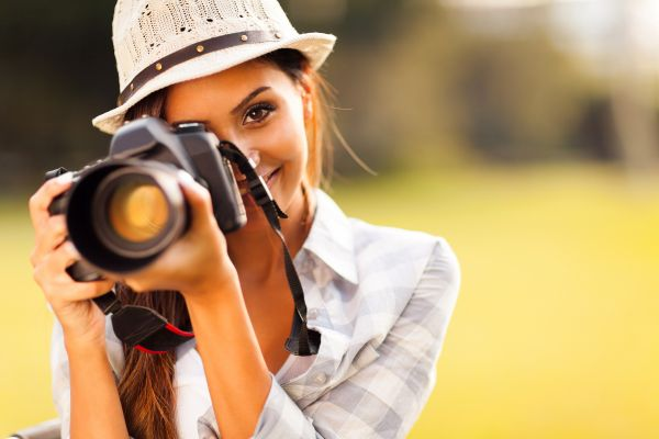 Woman Taking A Photograph | ISA Professional