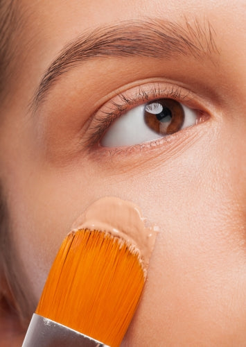Woman Applying Liquid Foundation- ISA Professional