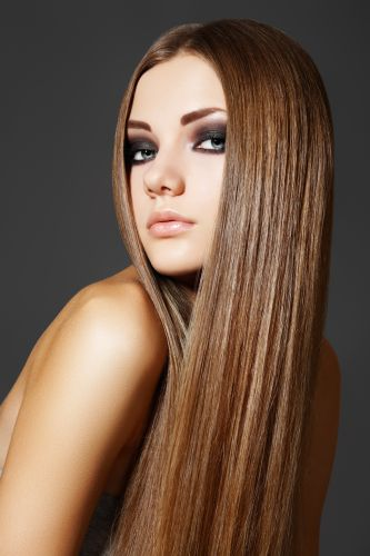 Woman With Sleek, Straight Hair- ISA Professional