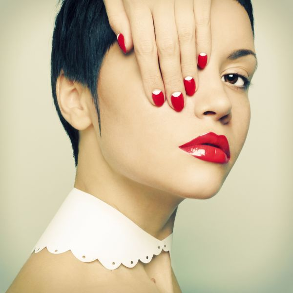 Girl Wearing Fire Red Nail and Lip Color ISA Professional