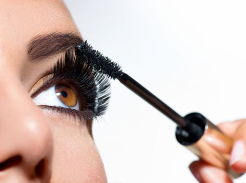 Girl Applying Mascara To Her Lashes- ISA Professional