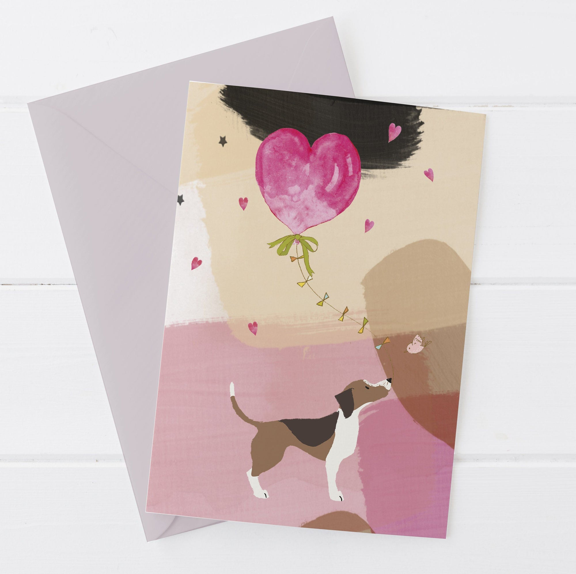 Dog Holding A Heart Greetings Card