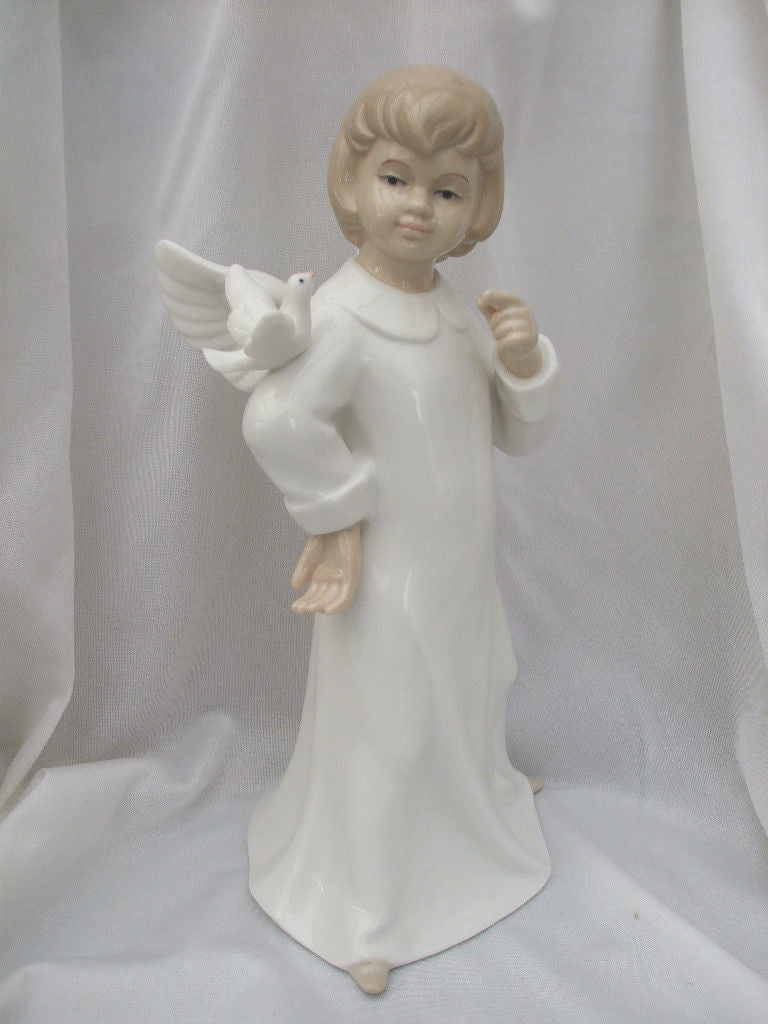Leonardo Porcelain Figurine  Tranquility  Boy with Dove - Louie's Gift Shop