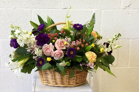 Basket of flowers for any occasion. Florist in Coral Gables.