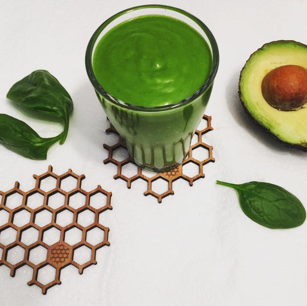 Green smoothie on honeycomb coasters