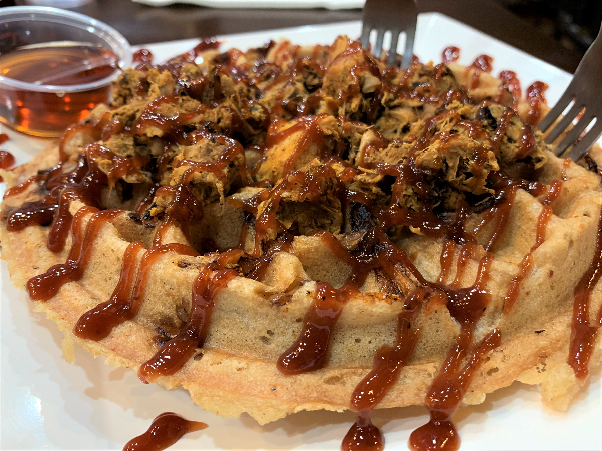 vegan waffle with jackfruit shredded chicken and barbecue sauce