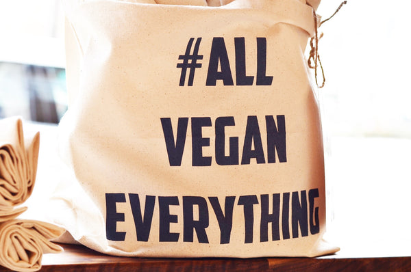 a cream canvas tote with hashtag all vegan everything on it