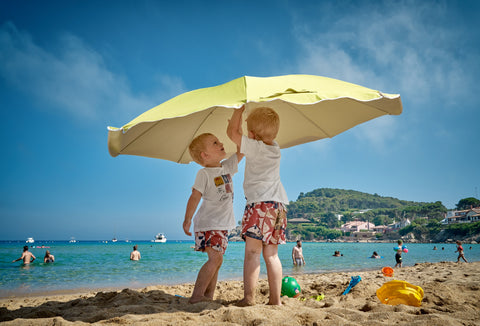 kids with beach umbrella