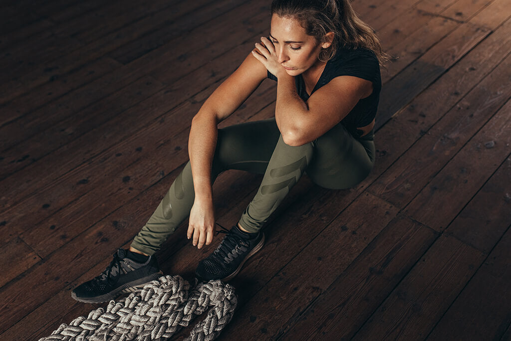 girl feeling unmotivated to exercise