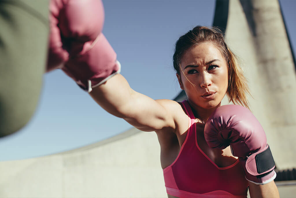 girl with a boxing trainer
