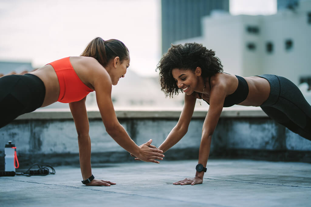 two girls working out together