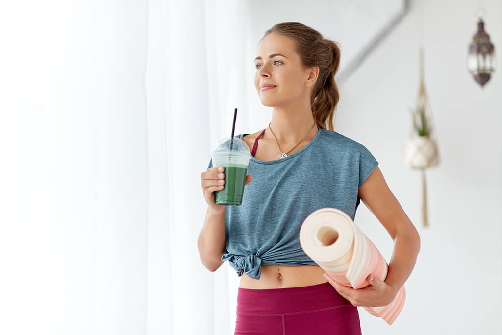 girl drinking a smoothie