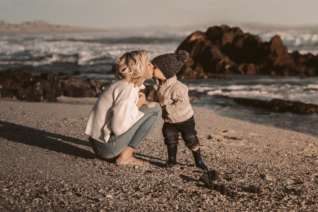 mom and child on a beach