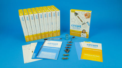 Circuit Scribe Kit shows the included modules, notebook, and conductive ink pen. Entry level electronics kit, eight pages of circuit drawing projects. Six modules are included.