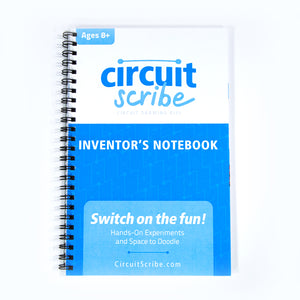 The Circuit Scribe Inventors Notebook with circuit projects on a white background. Rectangular notebook with blue and white writing. This notebook covers many concepts of electronics.