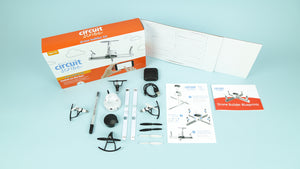 The DIY Drone builder kit with components, accessories, and conductive ink pen.